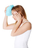 Woman with ice bag heaving headache Stock Image