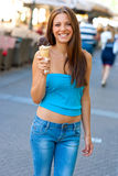 Woman with ice cream Stock Images