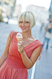 Woman with ice cream Stock Image
