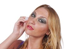 Woman with ice cube on her cheek Stock Photography