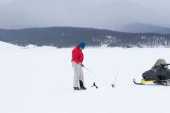 Woman Ice Fishing Royalty Free Stock Images