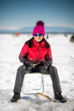 Woman ice-fishing in the winter Royalty Free Stock Photos