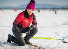 Woman ice-fishing in the winter Royalty Free Stock Photography