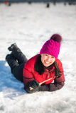 Woman ice-fishing in the winter Stock Photo