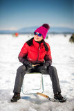 Woman ice-fishing in the winter Stock Image