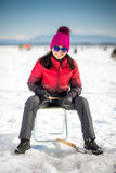 Woman ice-fishing in the winter Royalty Free Stock Images