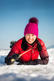 Woman ice-fishing in the winter Stock Images