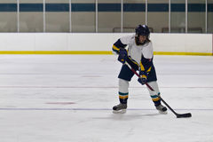Woman ice hockey player during a game Royalty Free Stock Photos
