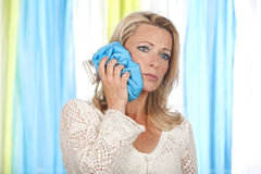 Woman with ice pack on her cheek Royalty Free Stock Photo