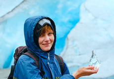 Woman with ice piece near Nigardsbreen glacier (Norway) Stock Photo