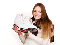 Woman with ice skates getting ready for ice skating. Winter sport activity. Smiling girl wearing warm clothing on white studio shot Stock Photo