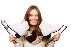 Woman with ice skates getting ready for ice skating. Winter sport activity. Smiling girl wearing warm clothing on white studio shot Stock Image
