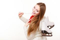 Woman with ice skates getting ready for ice skating. Winter sport activity. Smiling girl wearing warm clothing on white studio shot Royalty Free Stock Photos