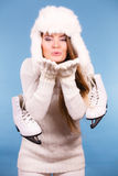 Woman with ice skates kiss gesture Royalty Free Stock Image