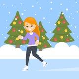 Woman ice skating. Woman ice skating between the christmas trees Royalty Free Stock Photos