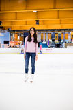 Woman ice skating indoor ice rink Stock Image