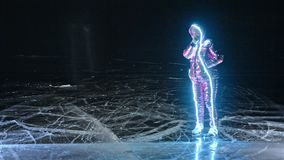 Woman is ice skating night. Girl to ride figure ice skates in nature. Woman riding together on ice in cracks. Magical. Angel on the ice. Outdoor winter fun for stock footage