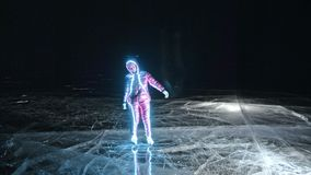 Woman is ice skating night. Girl to ride figure ice skates in nature. Woman riding together on ice in cracks. Magical. Angel on the ice. Outdoor winter fun for stock video footage
