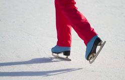 Woman ice skating outdoors Stock Image