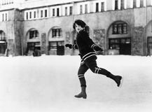 Woman ice skating outside Stock Images