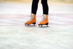 Woman ice skating. winter outdoors on ice rink. ice and legs stock photography