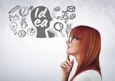 Woman with idea and business graphic drawings Stock Image
