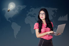 Woman with idea light bulb and laptop Royalty Free Stock Photography