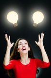 Woman and Idea Light Bulbs Stock Photos