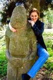 Woman and idol Royalty Free Stock Photo