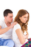 Woman ignoring her man partner in her bed during a conflict Royalty Free Stock Photos