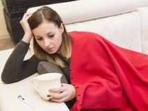 Woman illness sofa Stock Photos