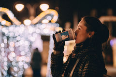 Woman on Illuminated Christmas Tree in City during Winter Royalty Free Stock Photos