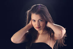 Woman illuminated by the light of the stage Royalty Free Stock Photo