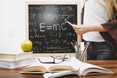 Woman Illustrating Albert Einstein Formula Stock Photo