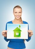 Woman with illustration of green eco house Royalty Free Stock Photos