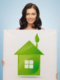 Woman with illustration of green eco house Stock Photo