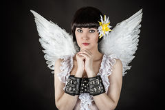 Woman in an image of an angel shackled Stock Photos