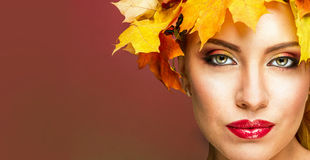 A woman in the image of autumn. Stock Photography