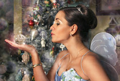 Woman in Image of Fairy and Christmas Gift royalty free stock photos