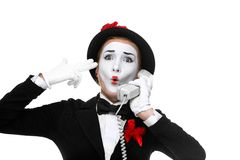 Woman in the image mime holding a handset Stock Photography