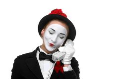 Woman in the image mime holding a handset Stock Image