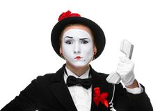 Woman in the image mime holding a handset Stock Photos
