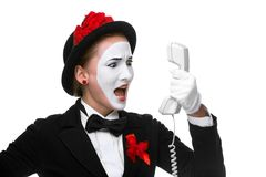 Woman in the image mime holding a handset Royalty Free Stock Photo