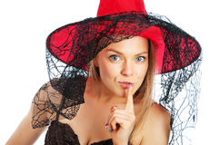 Woman in the image of the witch in the bell Royalty Free Stock Photography
