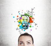 Woman imagining a light bulb Royalty Free Stock Image
