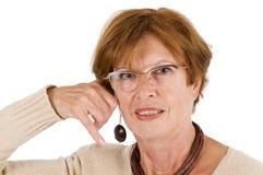 Woman imitating telephone Royalty Free Stock Photography