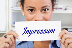Woman with imprint sign. Imprint sign in hands of a woman stock photos
