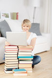 Woman improvising using books as a table Royalty Free Stock Image