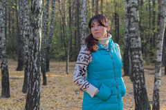 Free Woman In A Blue Jacket On The Background Of The Birches Royalty Free Stock Images - 75381649