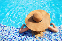 Free Woman In A Hat Enjoying A Swimming Pool Royalty Free Stock Photos - 29800728